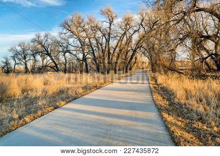 recreational trail along a river valley - Poudre River Corridor Trail near Winsor, Colorado