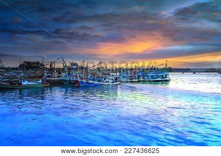 Fishing Boats In A Harbour And A Blue Sky Twilight.