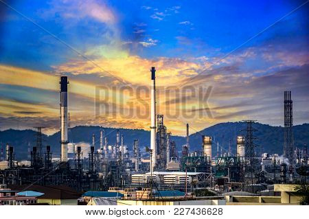 Oil Refinery At Twilight  Blue Sky Background