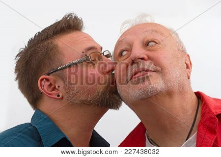 Happy Homosexual Couple On Bright Background. Shot In Studio.