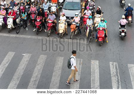 Hanoi, Vietnam - Oct 11, 2016: Aerial View Of Traffic On Dai La Street At Rush Hour, With A Boy Cros