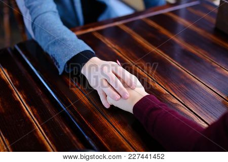 Bride And Groom Holding Hands Discuss Wedding And Honeymoon In Paris In Coffee House, Lovers On Date