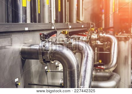 Industrial Factory, Steel Pipelines, Tubes At Brewery Production. Close Up Of Iron Pipes At Tool Equ
