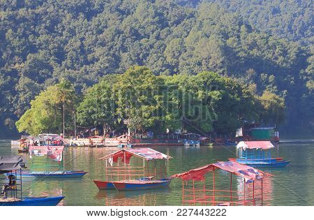Pokhara Nepal - November 7, 2017: Unidentified People Visit Tal Barahi Temple By Boat In Pokhara Nep