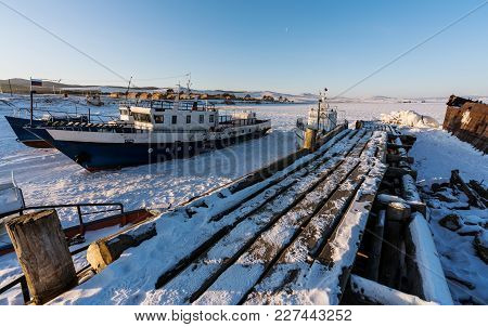 Winter Landscape, Abandoned Fishery Ships Parked On Snow At Frozen Lake Baikal, Russia In Winter