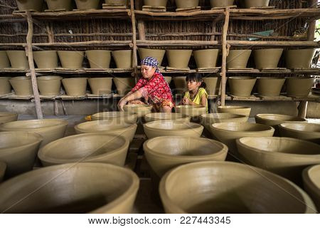 Kien Giang, Vietnam - Dec 6, 2016: Vietnamese Woman Making Clay Pots - Pottery Product By Hands In H