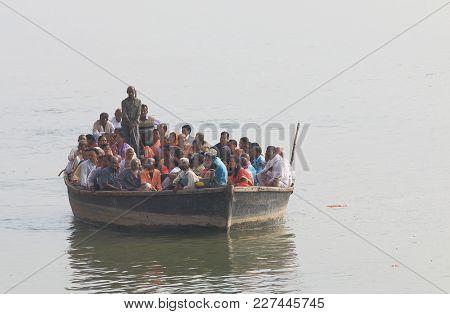 Varanasi India - November 2, 2017: Unidentified People Take Cruise Boat On Ganges River In Varanasi.