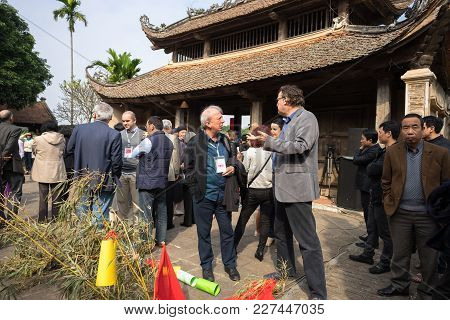 Hanoi, Vietnam - Jun 22, 2017: Foreigner Tourists Attend Vietnamese Traditional Holiday In Communal