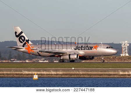 Sydney, Australia - May 5, 2014: Jetstar Airways Airbus A320 Airliner Landing At Sydney Airport.