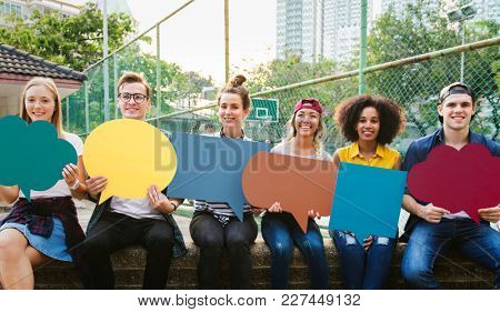 Friends holding up empty placard copyspace thought bubbles