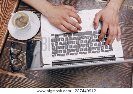 A Young Bank Employee Busy On A Laptop During Lunch Break
