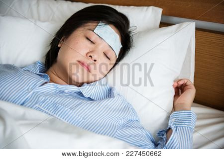 A woman suffering from fever
