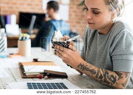 Caucasian woman taking a note from meeting