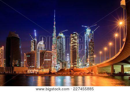 Dubai, UAE, April 2, 2016: View of Dubai downtown skyline at night with Burj Khalifa laser show