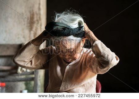 Ninh Binh, Vietnam - Apr 10, 2017: Portrait Of An Elderly Woman With White Hair Living Alone In The