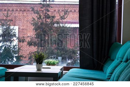 Office With Sofa And Table On A Window Background