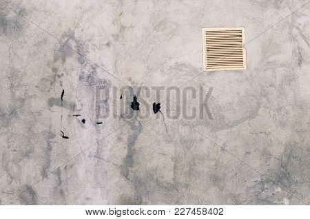 Grey Concrete Garage Wall With Spots Of Black Paint With White Ventilation Grille Abstract Backgroun