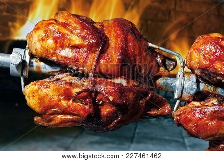 Delicious roasted chicken in the oven with fire