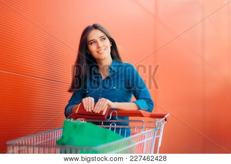 Happy Shopper Woman With Shopping Cart In Front Of Store