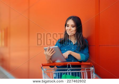 Shopping Woman With Pc Tablet And Pushcart Near Store