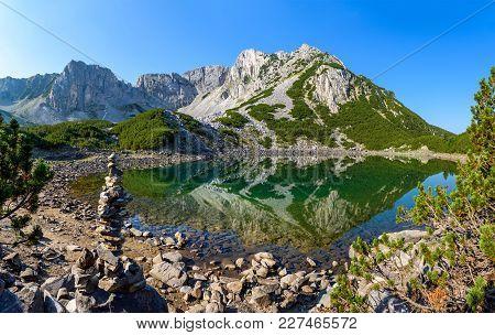 Reflection Of Sinanitsa Summit In Sinanitsa Lake, Pirin Mountains And National Park, Bulgaria