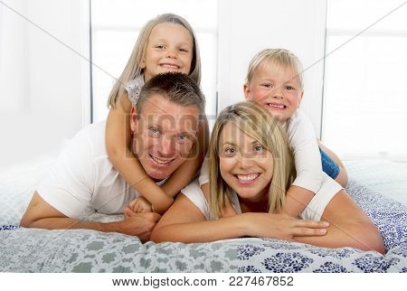 Young Beautiful And Radiant Couple 30 To 40 Years Old Smiling Happy Posing Sweet Lying On Bed With L