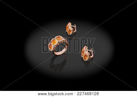 Yellow Gold Precious Earrings Ring With Diamonds On Black Background.