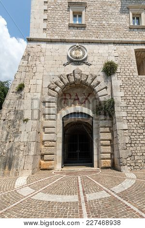 Monte Cassino, Italy - June 17, 2017: The Entrance Cloister Of Monte Cassino Abbey And The Death Of