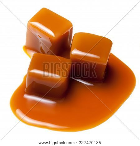 Brown Caramel Candies  Isolated On White Background.  Butterscotch Toffee Sauce. Pieces Of Caramel C