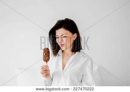 Beautiful Young Brunette Woman Having Refreshing Ice Cream. Happy Smiling Girl Having Fun And Eating