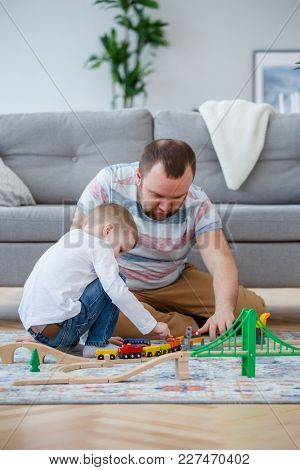 Picture of man and boy playing in toy road