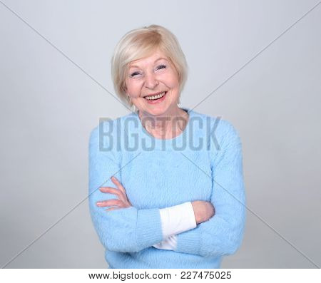 Portrait Of A Smiling Senior Woman. Beautiful Modern Grandmother. She Is Pensioner.
