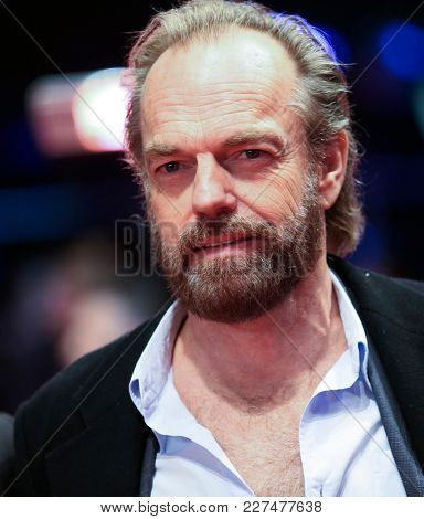 Hugo Weaving poses on the red carpet upon arrival for the premiere of the film 'Black 47' during the 68th Berlinale film festival on February 16, 2018 in Berlin.