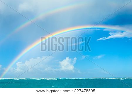 Double Rainbow Over The Ocean. Punta Cana Beach In The Dominican Republic. Nature Of The Caribbean I