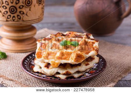 Honey Pouring On A Fresh Waffles. Breakfast With Waffles