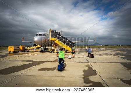 Phu Yen, Vietnam - Oct 22, 2016: Passengers Walking To Airplane For Boarding At Tuy Hoa Airport