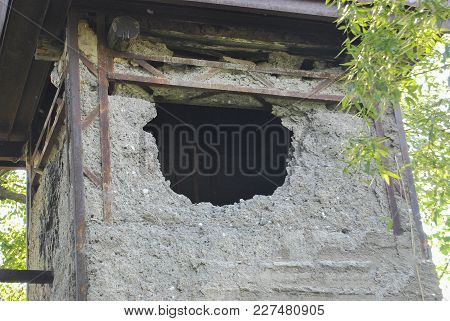 Old Building With A Hole. A Dilapidated, Abandoned Building.