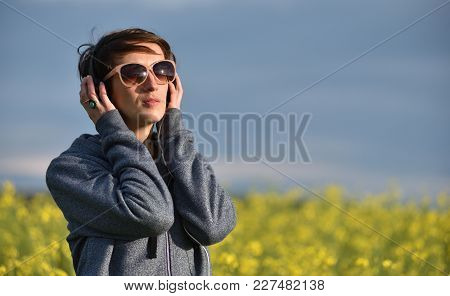 Grl Listening To Music In The Outdoors