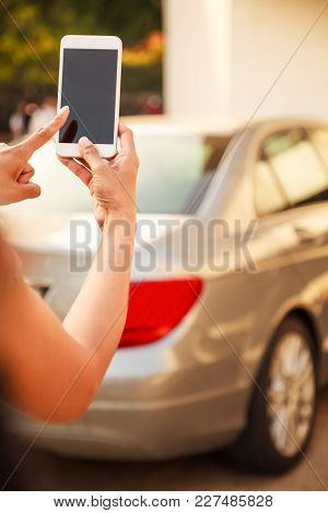 Female Lady Using App On Smart Phone Device, Technology Concept. Lady Hand Using Remote Control To S