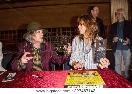Singer Martha Davis talks with singer Susan Cowsill at the Wild Honey Orchestra and Friends tribute to Buffalo Springfield meet-and-greet at the Alex Theatre in Glendale, CA on Feb. 17, 2018.