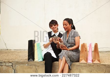 Female Lady Shopping Concept With Digital Technology. Asian Buddy Female Shoppers Happy Shopping Onl