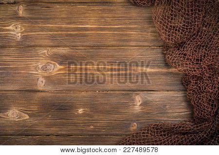 Wooden Background With Old Fishing Net. Background