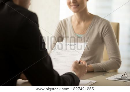 Close Up Image Of Contract Document In Businessman Hands. Male Entrepreneur Reading Text Of Business