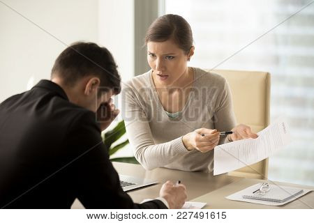 Unsatisfied Angry Female Client Pointing On Contract Terms While Requiring Satisfaction Of Claims Fr