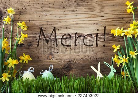 Wooden Background With French Text Merci Means Thank You. Easter Decoration Like Easter Eggs And Eas