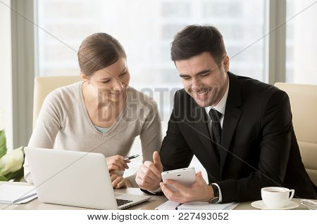 Smiling Businessman Presenting Promising Project Concept With Digital Tablet In Hand To Interested B