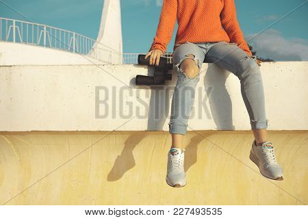 Unrecognizable Girl  Traveler With Binoculars Sits On A Balustrade And Looks Into The Distance