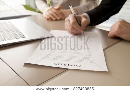 Close Up Image Of Paper Contract Document Lying At Work Desk With Laptop, Businessman Putting His Si