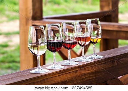 Glasses With Wine. Red, Pink, White Wine In Glasses. Set Of Glasses With Red, White And Rose Wine Ta