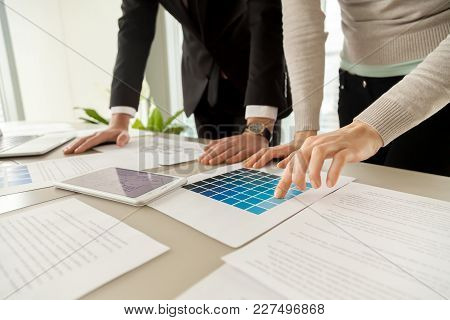 Smiling Woman Pointing On Blue Color On Pantone Swatch On Desk While Picking House Exterior Color Sc